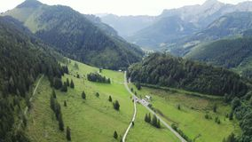 Road in alps. Mountain road in Austria Alps. Forest landscape with rocks and forest stock video footage