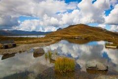 Mountain road in autumn landscape Stock Photos