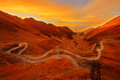 Mountain Road in Autumn Sunset Royalty Free Stock Image