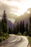 Mountain road in backlight with dreamy filtered effect Stock Photo