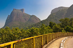 Mountain Road and Beautiful Landscape. Mountain Road with Pedra da Gavea and Pedra Bonita Rocks in the Horizon in Rio de Janeiro, Brazil Royalty Free Stock Images