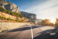 Mountain road and beautiful sky at sunrise. Colorful landscape stock images