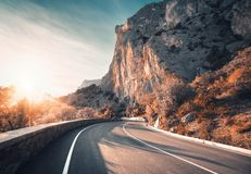 Mountain road and beautiful sky at sunset in autumn stock image