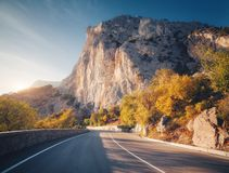 Mountain road and beautiful sky at sunset in autumn stock photos