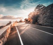 Mountain road and beautiful sky at sunset in autumn royalty free stock photography