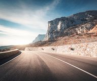 Mountain road and beautiful sky at sunset. Roadway royalty free stock photo