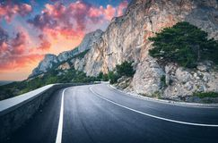 Mountain road and beautiful sky at sunset. Colorful landscape stock images