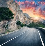 Mountain road and beautiful sky at sunset. Colorful landscape royalty free stock image
