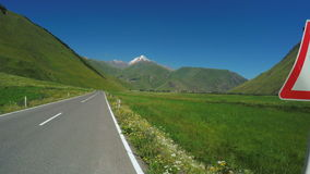 Mountain road from bike stock video footage