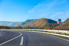 Mountain road bright autumn day with blue sky Stock Photography