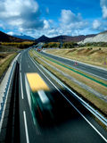 Mountain road with bright blue sky background. Motorway with traffic on mountains in a bright blue sky day Stock Photography