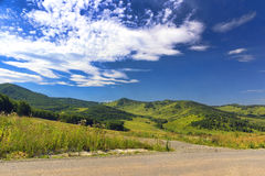 Mountain road. In the bright summer afternoon Stock Images