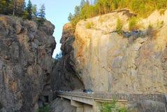 Mountain road through canyon Stock Images