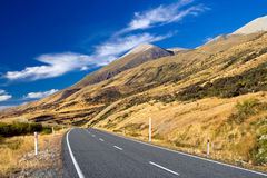 Mountain road on clear sunny day of autumn Royalty Free Stock Image