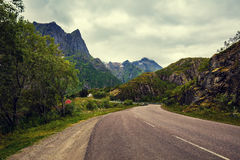 Mountain road with cloudy sky Royalty Free Stock Images