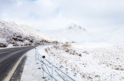 Mountain road on a cloudy winter day. Stock Photos