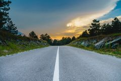 Mountain road with colorful sky stock photo