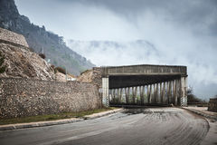 Mountain road with concrete tunnel structure Royalty Free Stock Image