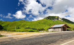 Mountain road in countryside of Lao. In sunlight outdoor with blue sky and many cloud Royalty Free Stock Photos