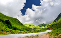 Mountain road in countryside of Lao. In sunlight outdoor with blue sky and many cloud Royalty Free Stock Image