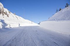 Mountain road covered in snow. Way to the ski lift Stock Image