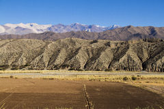 Mountain, road and cultivated fields in Argentina Stock Photos