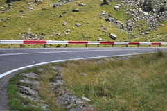 Mountain road curve to right. Fagaras mountains, alpine highway, , mountain road curve to right stock photo