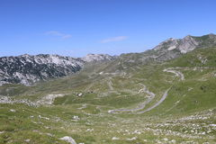 Mountain road Durmitor. Montenegro Durmitor mountain. The narrow path leading to the farthest villages Royalty Free Stock Photo