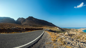 Mountain road at eastern coast of Crete island, Greece Royalty Free Stock Photography