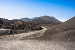 Mountain road on Etna volcano. Mount Etna landscape. Sicily, Ita Royalty Free Stock Photo