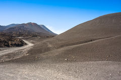 Mountain road on Etna volcano. Mount Etna landscape. Sicily, Ita Royalty Free Stock Images