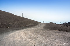 Mountain road on Etna volcano. Mount Etna landscape. Sicily Royalty Free Stock Photography
