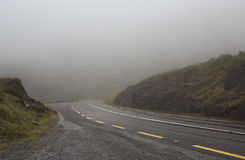 Mountain road in the fog. Stock Photo