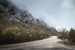 Mountain road in foggy day, rainy landscape Royalty Free Stock Images