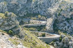 Mountain road that goes towards Sa Calobra, in the islands of Mallorca. View from above of several of the curves in the Sierra de Tramontana Stock Photo