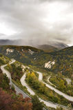 Mountain road with hairpin. View of a mountain road with hairpin turns during the late fall stock images