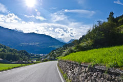 Mountain road. In the Italian Alps, lot of ultraviolet from bright sun Royalty Free Stock Photography
