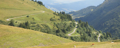 Mountain road in lace. From the famous french Aravis pass - France - The Alps - Panorama Stock Images