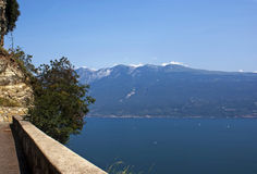 Mountain road by the lake Garda. View from the car on the mountain road by the lake Garda on the high speed, Italy Royalty Free Stock Image