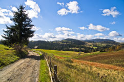 Mountain road and landscape at autumn sunny day, Radocelo mountain Stock Images