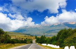 Mountain road. The mountain road, landscape and the blue sky royalty free stock images
