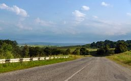 Mountain road. The mountain road, landscape and the blue sky royalty free stock image