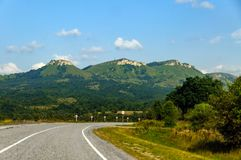 Mountain road. The mountain road, landscape and the blue sky stock images