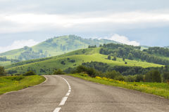 The mountain road leaving afar Stock Photos