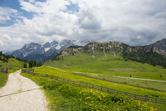 Mountain road in the meadows of the Italian Dolomites Royalty Free Stock Photos