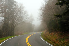 Mountain road in the mist Stock Images