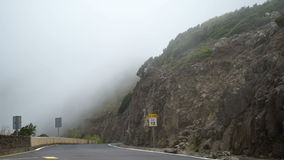Mountain Road In The Mist. Filmed From A Road stock video footage