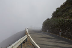 Mountain road in the mist Royalty Free Stock Photo