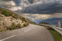 Mountain road and moody skies in Corsica Stock Photos