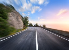 Mountain road in motion blur effect at sunset Stock Images